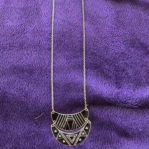 Long Aztec print black and gold necklace